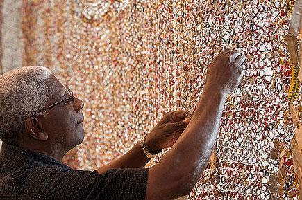 El Anatsui creating his wall installation | Image by Nash Baker
